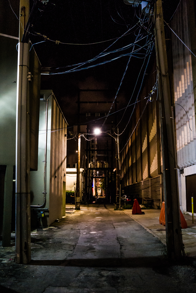 Should we stumble across this dark alley or avoid trouble and go straight to the vehicle? My sense of adventure had waned by this point, but I managed to grab this shot regardless.